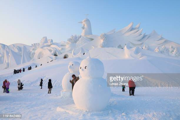 Tourists visit the Harbin International Snow Sculpture Art Expo on January 5 2020 in Harbin China Harbin Ice Sculpture Festival is one of the...