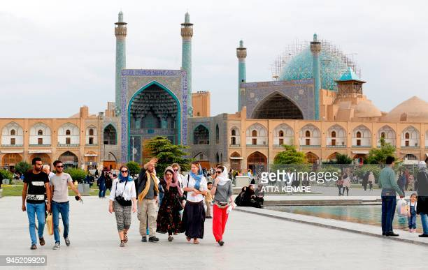 Tourists visit the historical Naqsh-e Jahan Square in Isfahan on April 12, 2018. / AFP PHOTO / ATTA KENARE