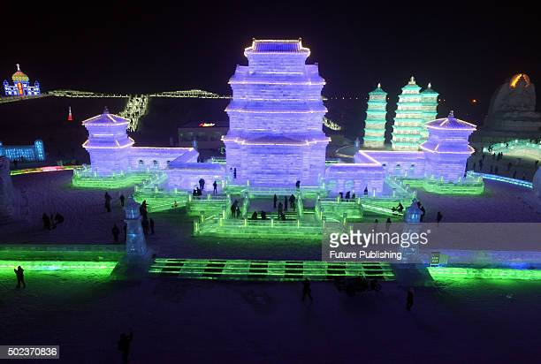 Tourists visit the ice and snow world at the 32nd Harbin International Ice and Snow Festival on December 22 2015 in Harbin Northeast China's...