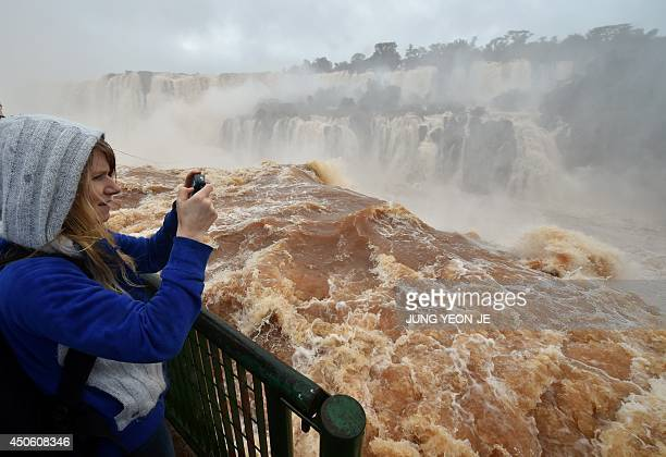 Tourists visit the Iguazu Falls in Foz do Iguacu Parana on June 14 2014 during the 2014 FIFA World Cup in Brazil South Korea's national football team...