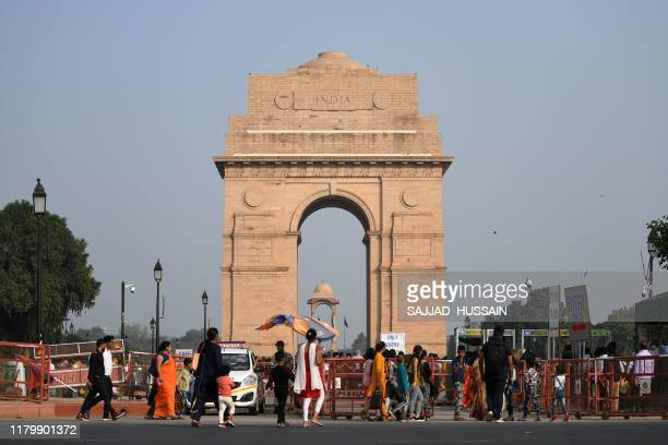 Tourists visit the India Gate in New Delhi on November 4 a day after toxic smog engulfed the India's capital India's capital New Delhi was enveloped...