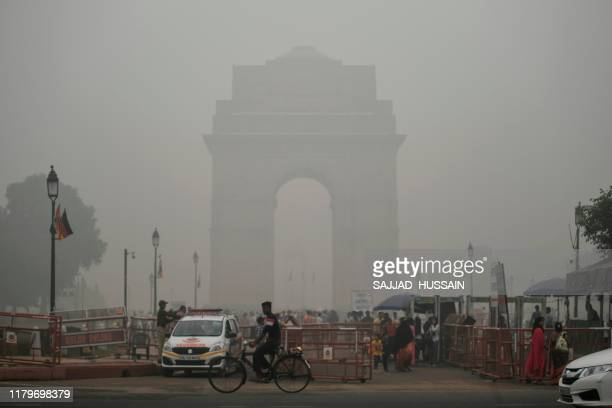 Tourists visit the India Gate under heavy smog conditions in New Delhi on November 3 2019 India's capital New Delhi was enveloped in heavy toxic smog...