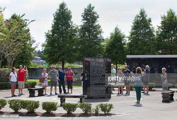 Tourists visit the Katrina Memorial at Charity Hospital Cemetery in Mid City New Orleans LA on Friday afternoon before the storm's tenth anniversary...