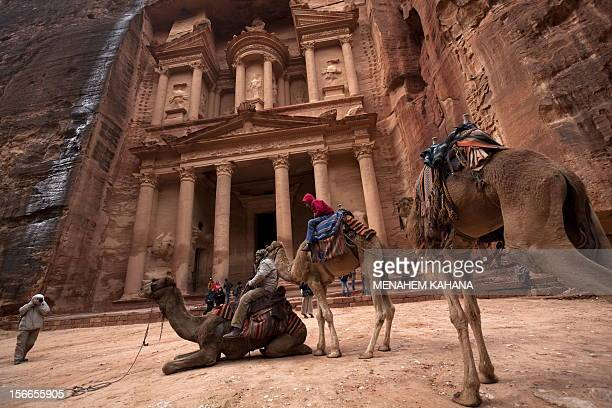 Tourists visit the Khazneh at Petra on February 27 2010 Established as the capital city of the Nabataeans the rose rock city is Jordan's most popular...