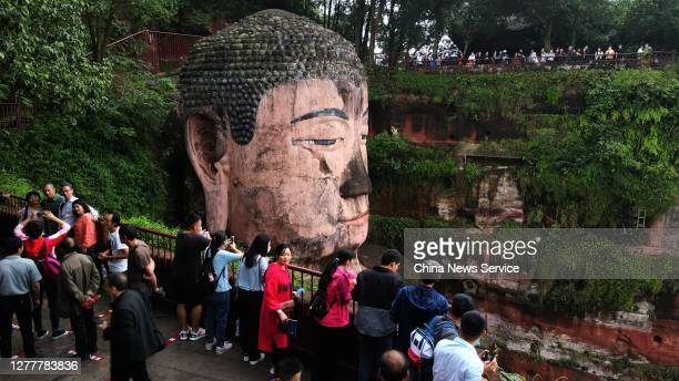 Tourists visit the Leshan Giant Buddha, a UNESCO World Heritage Site, on the first day of the eight-day National Day holiday on October 1, 2020 in...