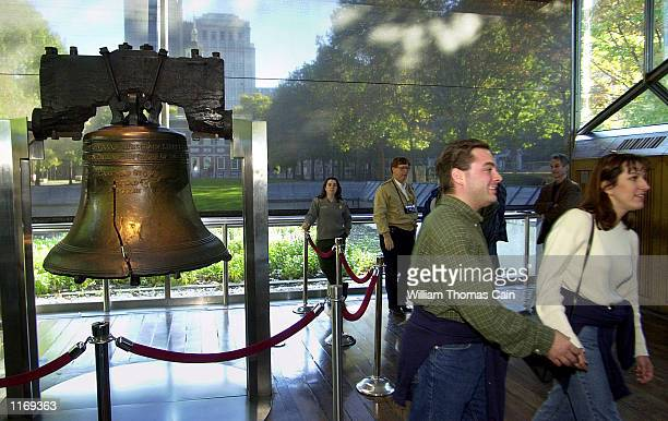 Tourists visit the Liberty Bell after going through a metal detector, not shown, at the Liberty Bell Pavilion, October 8 in Philadelphia. Officials...