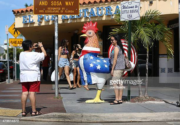 Tourists visit the Little Havana neighborhood as the Florida Governor Rick Scott announced that the state set a record in tourism numbers for the...