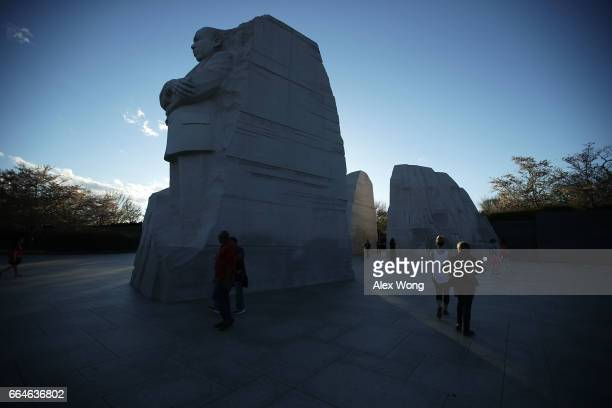 Tourists visit the Martin Luther King Jr Memorial April 4 2017 in Washington DC The Memorial Foundation held its annual candlelight vigil to mark the...