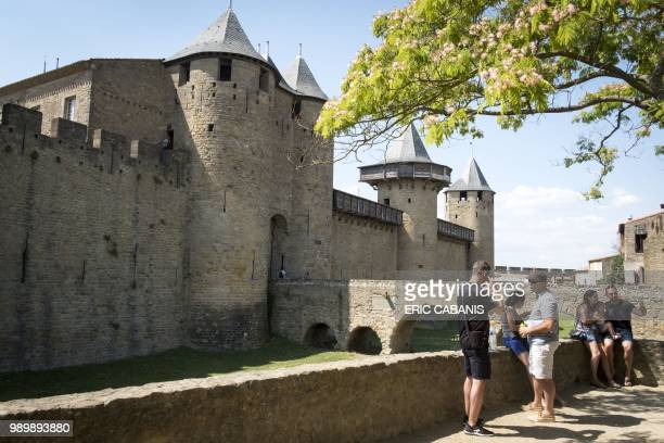 Tourists visit the medieval fortified city of Carcassonne southern France on July 2 2018