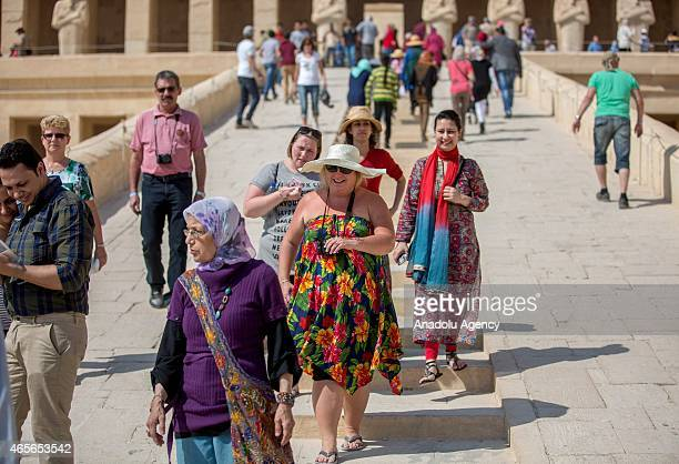 Tourists visit the Mortuary Temple of Hatshepsut at located on the west bank of the Nile Luxor Egypt on February 4 2015 Hatshepsut doughter of...