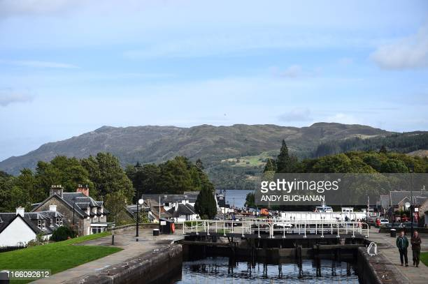 Tourists visit the mouth of the Caledonian Canal that feeds into Loch Ness in Drumnadrochit, Scotland, on September 5, 2019.