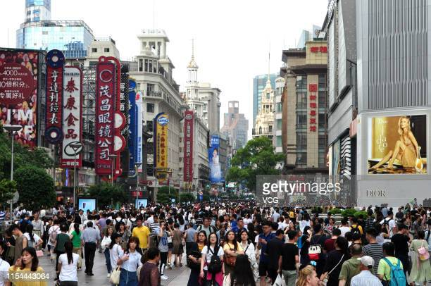 Tourists visit the Nanjing Road Pedestrian Street on the first day of the three-day Dragon Boat Festival holiday on June 7, 2019 in Shanghai, China....