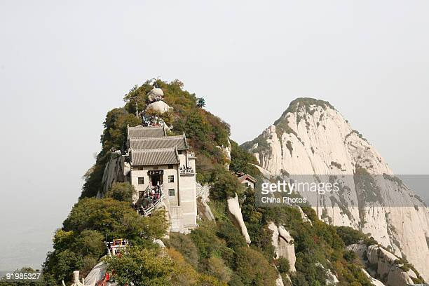 Tourists visit the North Peak of the Huashan Mountain on October 18 2009 in Huayin Shaanxi Province China Huashan located at an altitude of 21549...