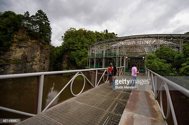 Tourists visit the Opera de Arame or the Wire Opera House a theatre house built out of steel tubes situated in the middle of an urban green park...