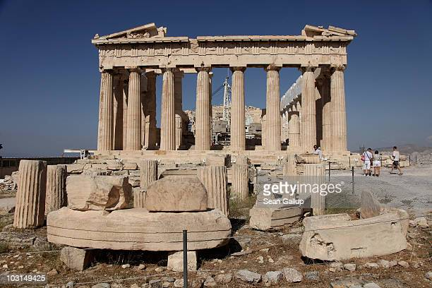 Tourists visit the Parthenon at the Acropolis on July 17 2010 in Athens Greece The Parthenon is the country's most famous landmark and draws...