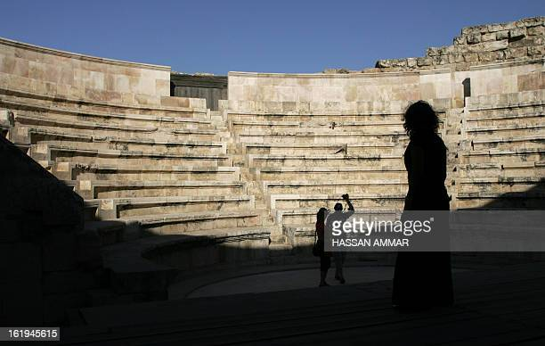 Tourists visit the Roman amphitheatre in downtown Amman 17 June 2007 The restored amphitheatre which dates back to the 2nd century AD is built into...