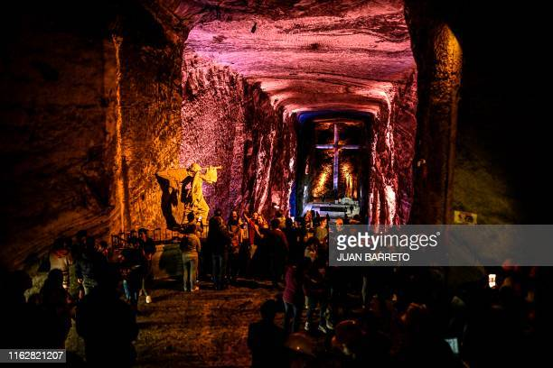 Tourists visit the Salt Cathedral of Zipaquira, an underground church built into a mine that produces salt, 45 km north of Bogota, on August 19, 2019.