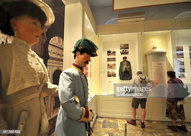 Tourists visit the Sarajevo museum on June 28 during an exhibition marking the 100th anniversary of the assassination of AustroHungarian heir to the...