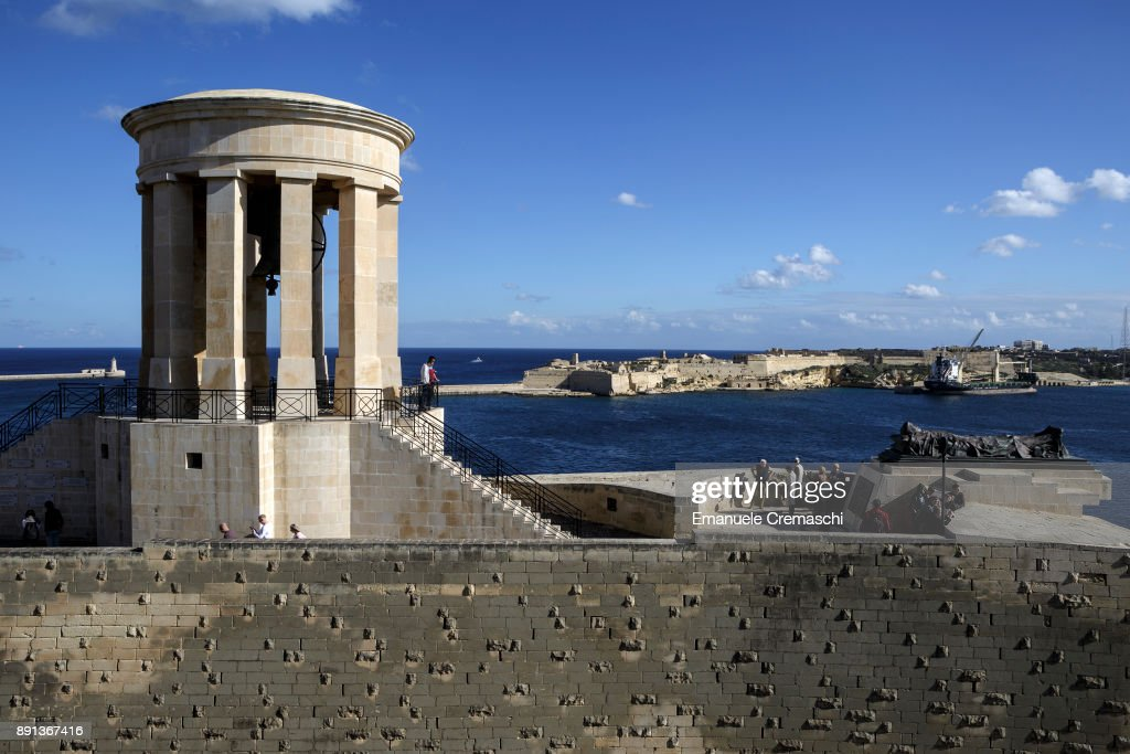 Tourists visit the Siege Bell War Memorial on December 9, 2017 in Valletta, Malta. Valletta, a fortified town that dates back to the 16th century, is the southernmost capital of Europe and a UNESCO World Heritage Site: together with all the Maltese islands, it will be hosting the title of European Capital of Culture in 2018.