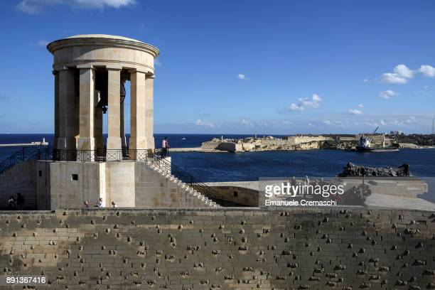 Tourists visit the Siege Bell War Memorial on December 9 2017 in Valletta Malta Valletta a fortified town that dates back to the 16th century is the...