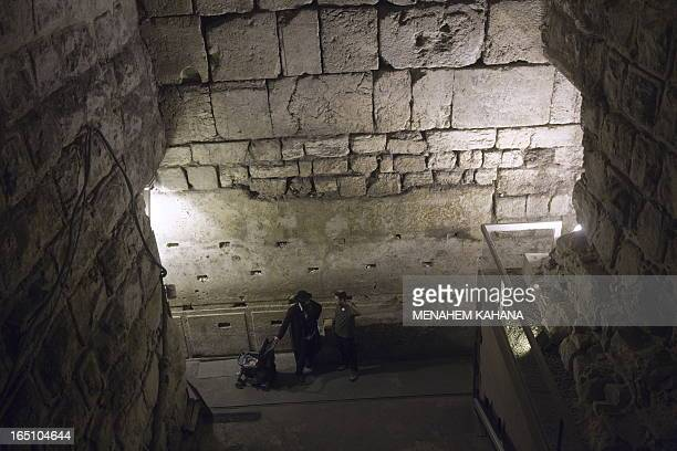 Tourists visit the site of excavations in the Western Wall tunnels on October 22 2009 in Jerusalem's old city during a tour organized by the Israeli...