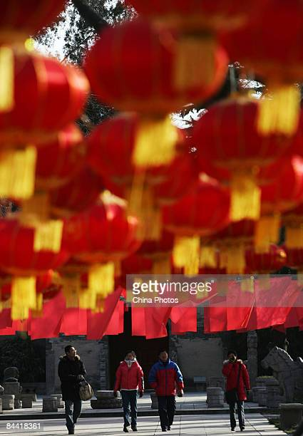 Tourists visit the Small Wild Goose Pagoda adorned with lanterns for the upcoming Chinese New Year on January 23 2009 in Xian of Shaanxi Province...