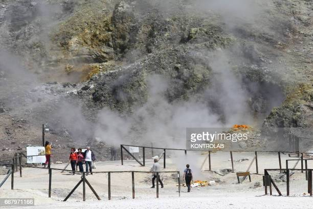 POZZUOLI NAPLES CAMPANIA ITALY Tourists visit the Solfatara crater part of the Campi Flegrei Volcano the biggest caldera of Italy