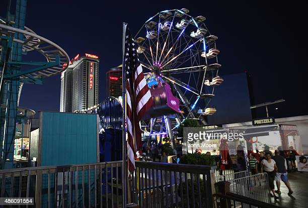 Tourists visit the Steel Pier amusement park on August 26 2015 in Atlantic City New Jersey After years of economic decline in Atlantic City in 2014...