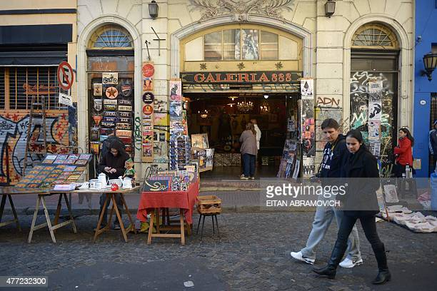 Tourists visit the street market of San Telmo neighborhood in Buenos Aires Argentina on June 14 2015 San Telmo is one of the oldest neighborhoods of...