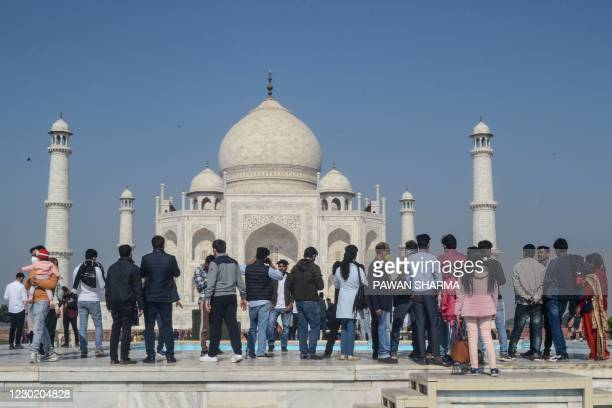 Tourists visit the Taj Mahal in Agra on December 19 as India surged past 10 million Covid-19 coronavirus cases.