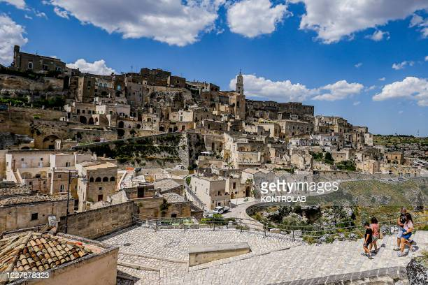 """Tourists visit the the old town. Also named the city of stones, Movie set for movies as """"The Gospel according to Mattew"""" directed on 1964 by..."""