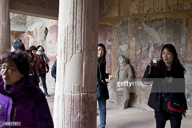 Tourists visit the Thermae Stabianae, the baths restored and reopened after a two-year work at the archeological site of Pompeii on March 8, 2012....