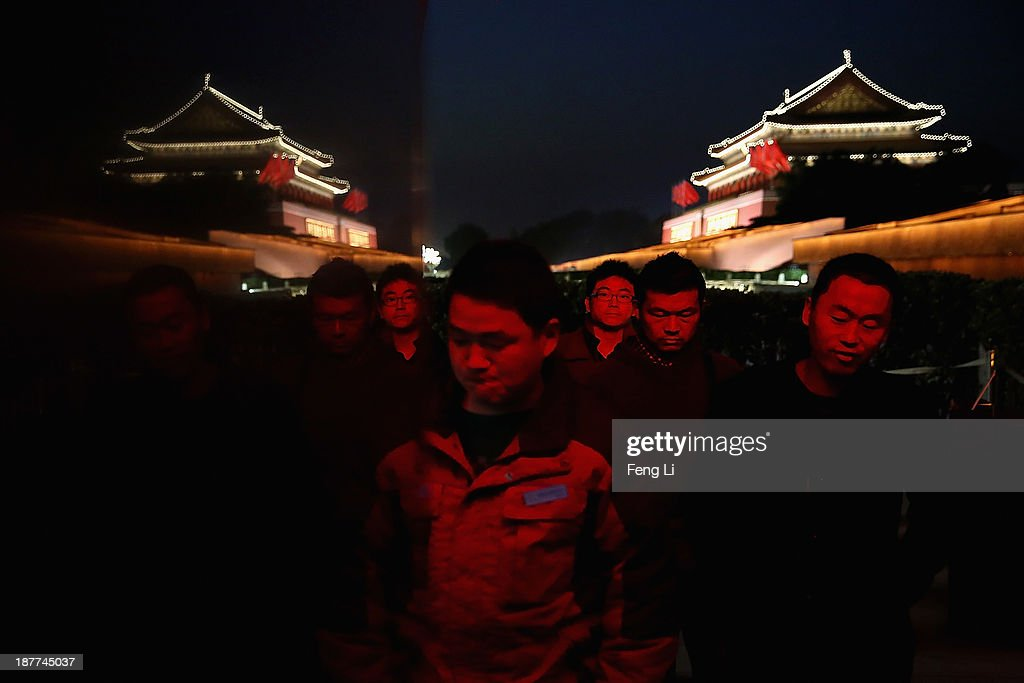 Tourists visit the Tiananmen Square outside the Great Hall of the People where the Communist Party's 205-member Central Committee gathered for its third annual plenum on November 12, 2013 in Beijing, China. The 18th Central Committee of the Communist Party of China (CPC) approved a decision on 'major issues concerning comprehensively deepening reforms' at the close of the Third Plenary Session of the 18th CPC Central Committee on Tuesday.