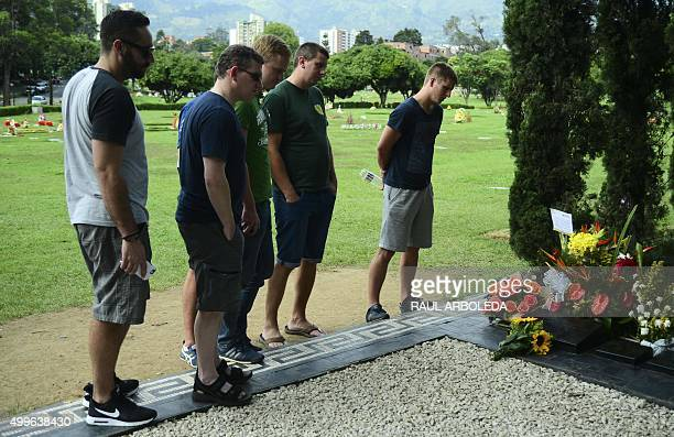 Tourists visit the tomb of Colombian drug lord Pablo Escobar at the Montesacro cemetery in Medellin Antioquia department Colombia on December 2 2015...