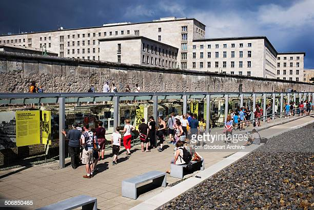 Tourists visit the Topography of Terror museum situated along side the remaining 200 metres of the Wall at Niederkirchnerstrasse which marked the...