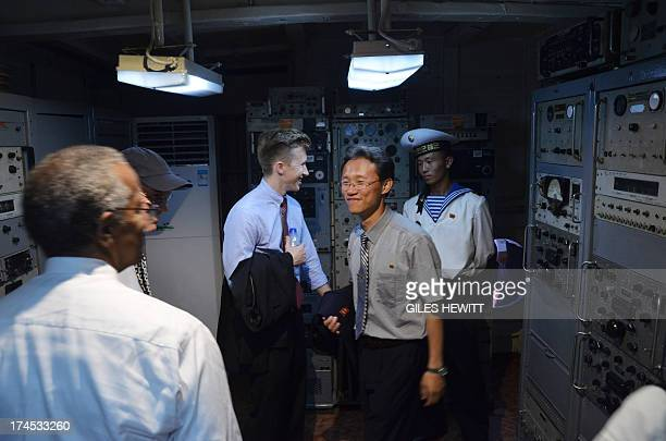 Tourists visit the USS Pueblo a US navy technical research ship captured by North Korean forces in 1968 in Pyongyang on July 27 2013 North Korea...
