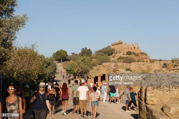 Tourists visit the Valley of the Temples or Valle dei Templi on August 13 in Agrigento, on the southern Italian island of Sicily.