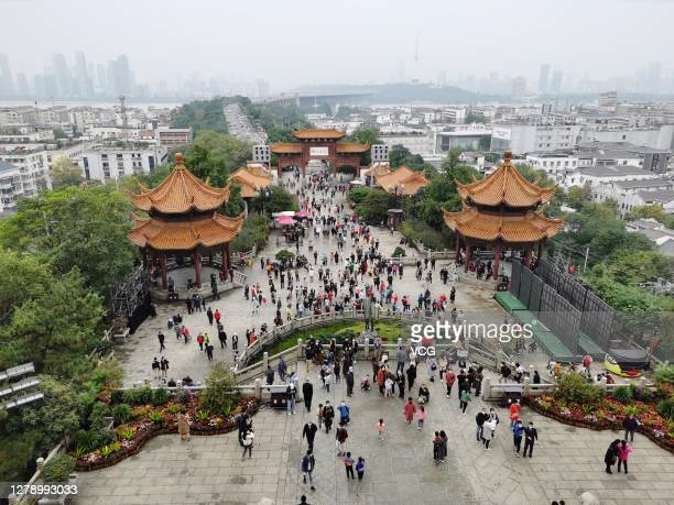 Tourists visit the Yellow Crane Tower Park during 8day National Day holiday on October 6 2020 in Wuhan Hubei Province of China