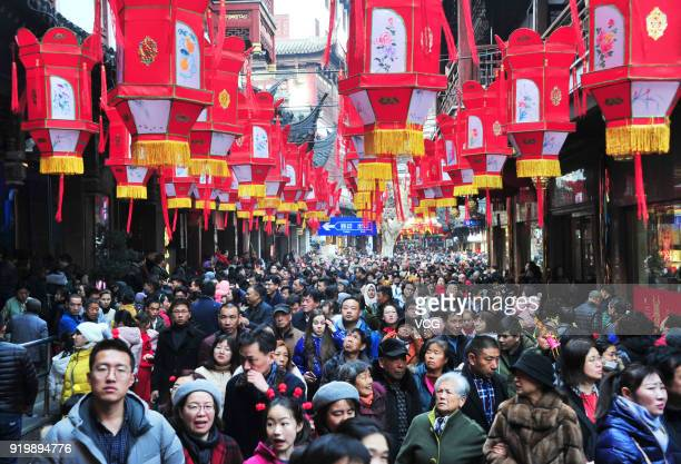 Tourists visit the Yuyuan Garden on February 17 2018 in Shanghai China The 2018 Chinese New Year which is the year of the dog begins on Friday and...