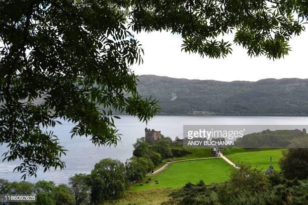 Tourists visit Urquhart Castle on Loch Ness in Drumnadrochit, Scotland, on September 5, 2019.