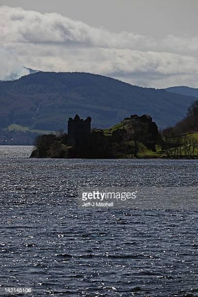 Tourists visit Urquhart Castle on Loch Ness on March 30 2012 in Drumnadrochit United Kingdom