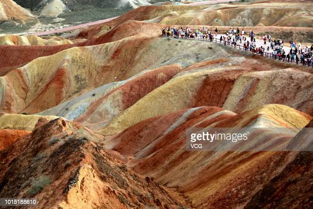 Tourists visit Zhangye National Geopark on August 7, 2018 in Zhangye, Gansu Province of China.