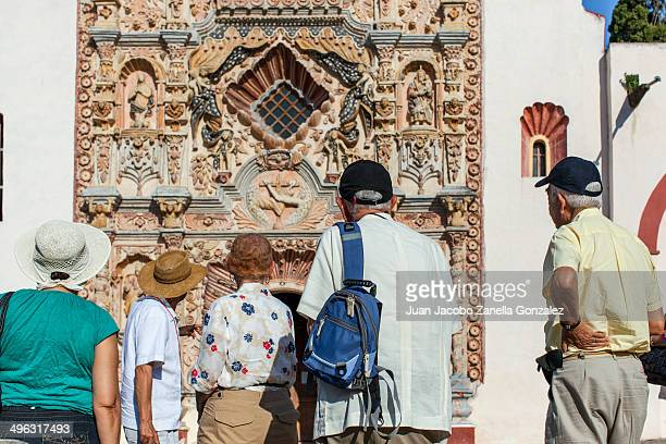 CONTENT] Tourists visiting and admiring the facade of the Tilaco Mission one of the five Missions of the Sierra Gorda in Queretaro Mexico listed in...