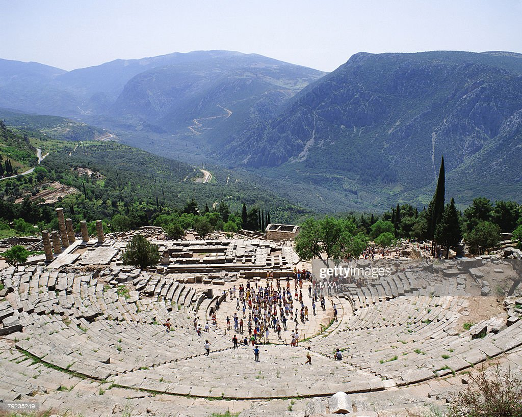 Tourists visiting archaeological site in Delphi, Greece : Stock Photo