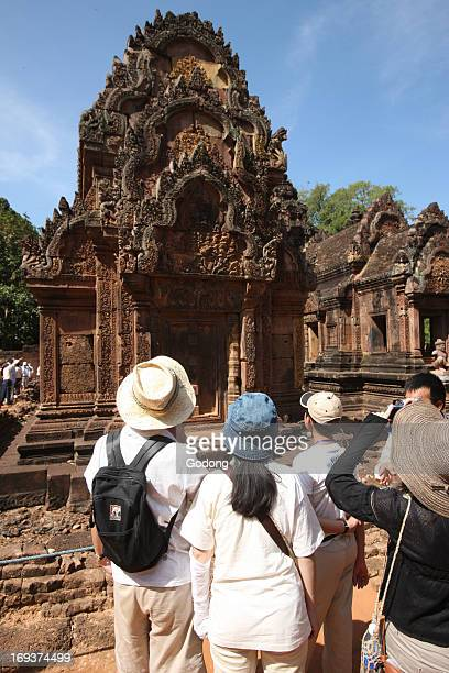 Tourists visiting Banteay Srei Temple at Angkor in Cambodia.