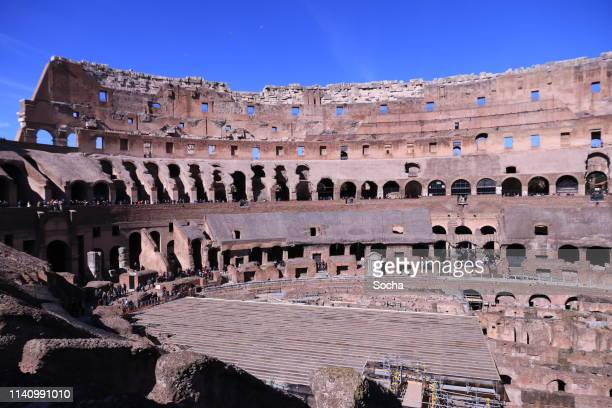 tourists visiting colosseum - restoration style stock pictures, royalty-free photos & images