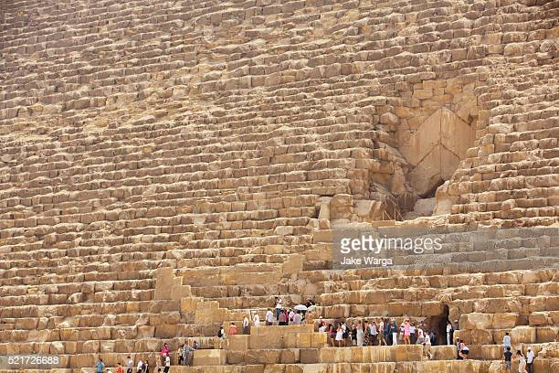 tourists visiting great pyramid, giza, egypt - jake warga stock photos and pictures
