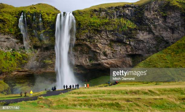 Tourists visiting Seljalandsfoss