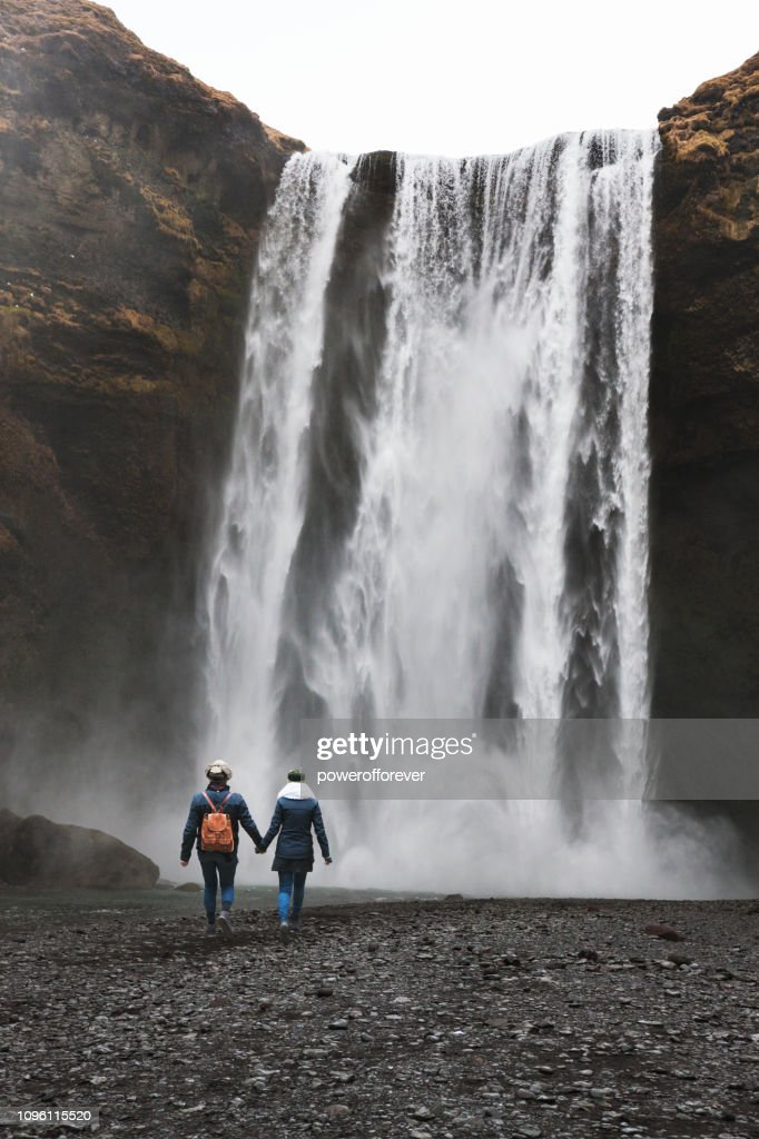 Tourists Visiting Skógafoss Waterfall at Skógar in Iceland : Stock Photo