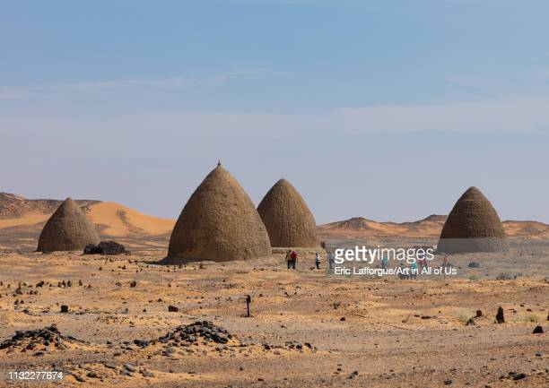 Tourists visiting the beehive tombs Nubia Old Dongola Sudan on December 25 2018 in Old Dongola Sudan
